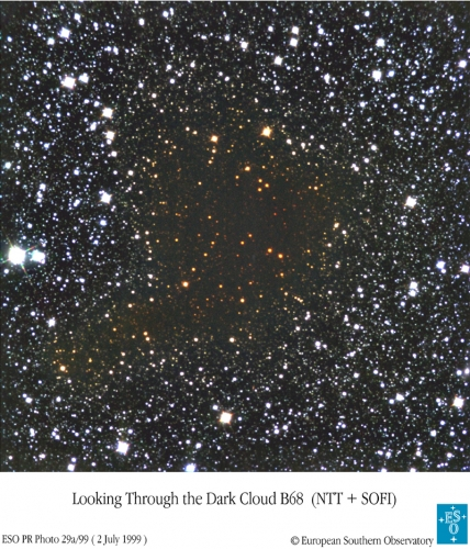 Telescopic image of Barnard 68 taken through infrared filters showing the reddening of starlight by this foreground cloud.