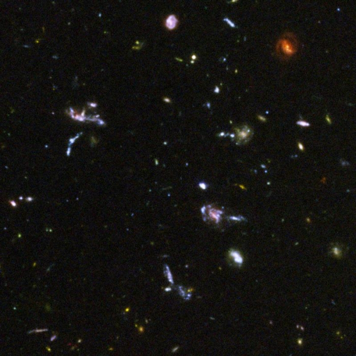 Portion of Hubble Ultra Deep Field image showing young galaxies explained in text