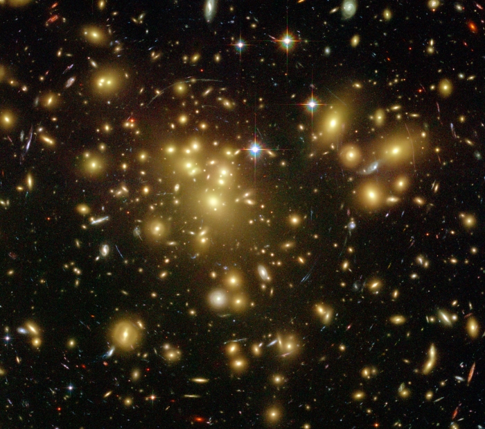 Hubble image of a cluster lensing a background galaxy