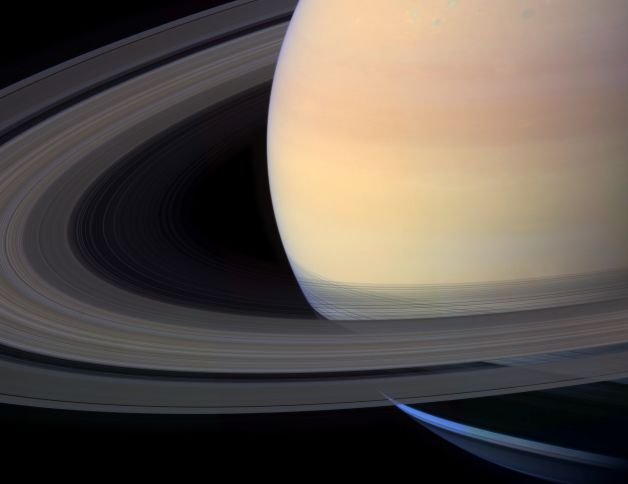 Saturn's aesthetic appeal, only shows half the planet with the rings