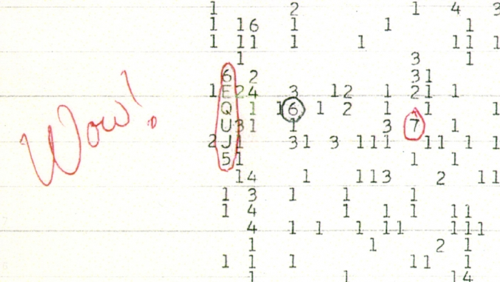 Image of hand-written note detecting a radio signal that spells wow
