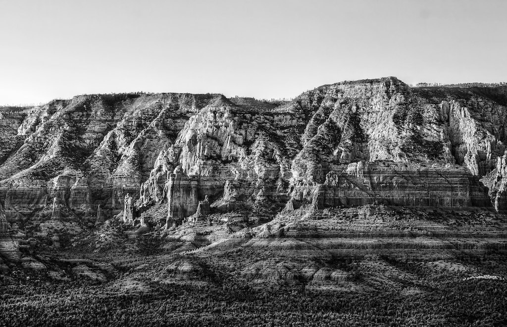 black and white image of a striated cliff side