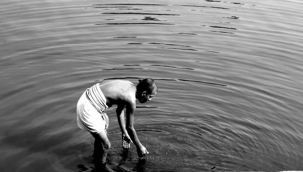 image of man making small ripples in water