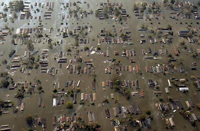 Aerial view of houses surrounded by water in aftermath of Hurricane Katrina