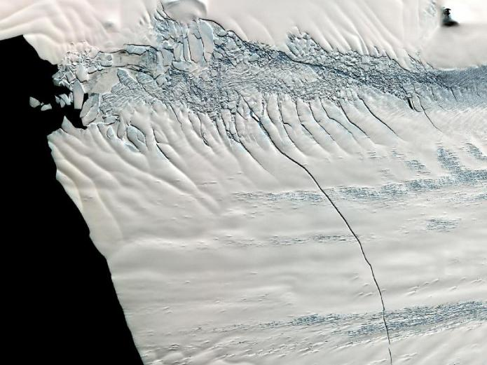 Crack recently exposed in the Pine Island Glacier, Antarctica, evidence that the glacier may soon break up