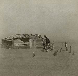 Man and two children in front of shack in the 1930s Dustbowl in Cimmaron County, OKlahoma
