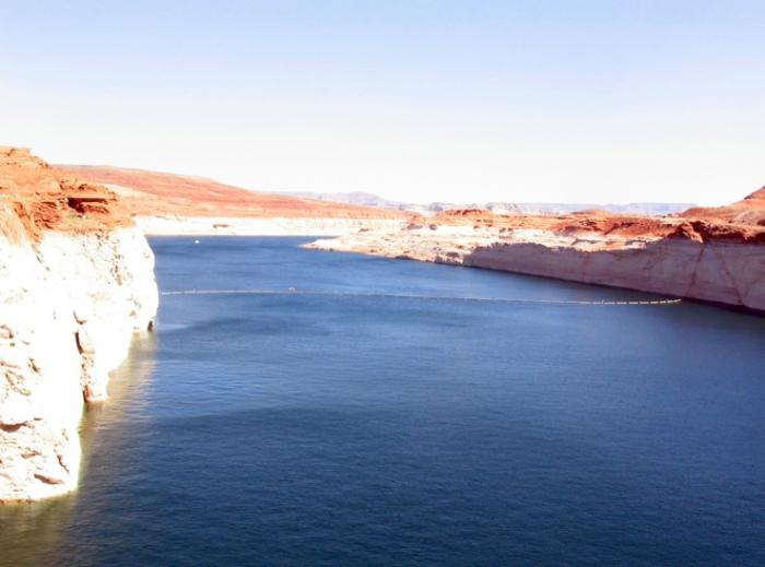 Water above Glen Canyon Dam on Colorado River in Arizona at higher elevation than water below the dam.