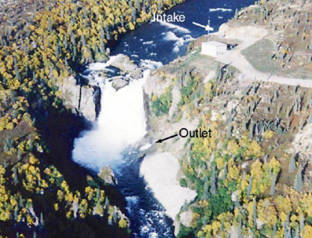Diversion dam. Water falls naturally, no infrastructure. Intake diverts some water and outlet releases it at the bottom of waterfall