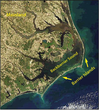 Satellite image Outer Banks, approximately 300 km long string of barrier islands off coast of North Carolina, U.S., described in caption.