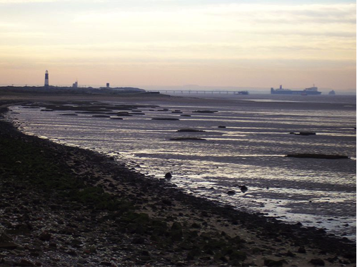 Land based picture of Humber Estuary in Britain, described in caption.