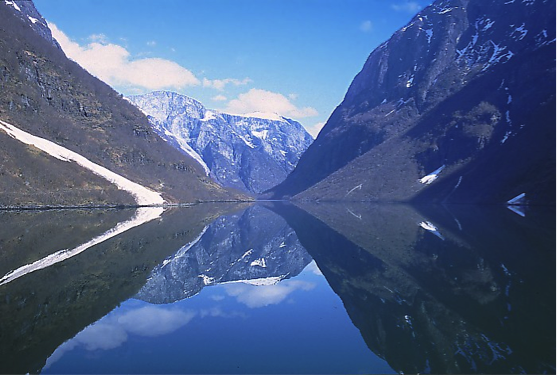 Sognefjord of Norway. water between two mountains and a mountain at the end