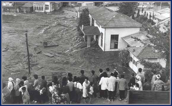 1960 Onagawa Japan people looking at the destruction left from the tsunami - nothing left