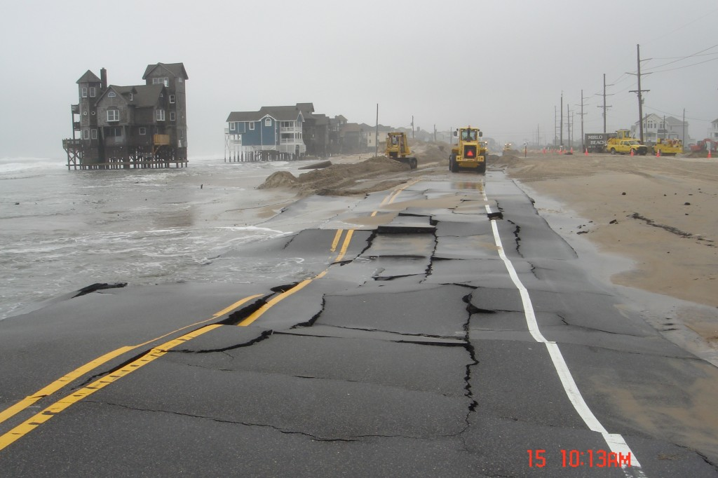 Road damage from storms in Rodanthe. Road is wavy and cracked