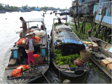 Boats loaded with goods near the city of Mỹ Tho in the Mekong Delta