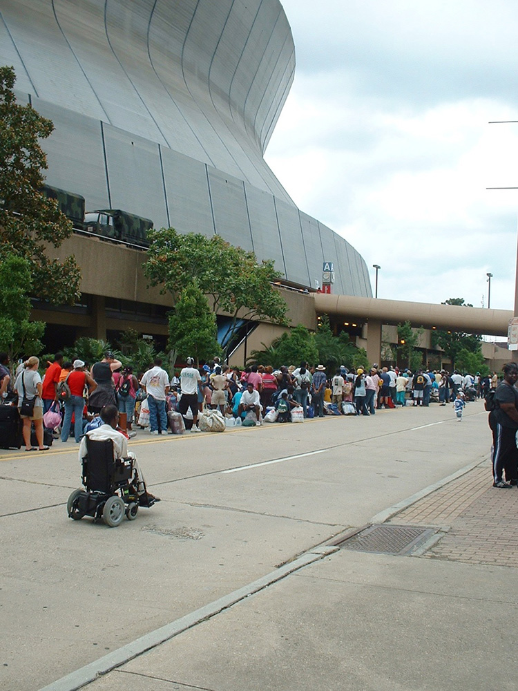 image of people in line for aid after Katrina
