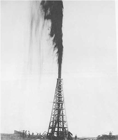 Old black and white photo of oil gushing into the air