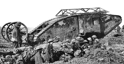 Black and white photo of a British tank on top of a trench