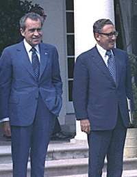 Color photo of Richard Nixon and Henry Kissinger standing outside
