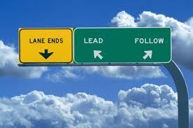 mock photograph of street signs: lane ends, lead, follow