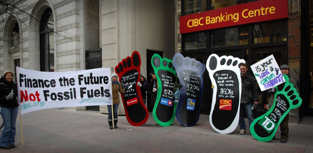 Protesters protesting against fossil fuel investments by banks in Canada.