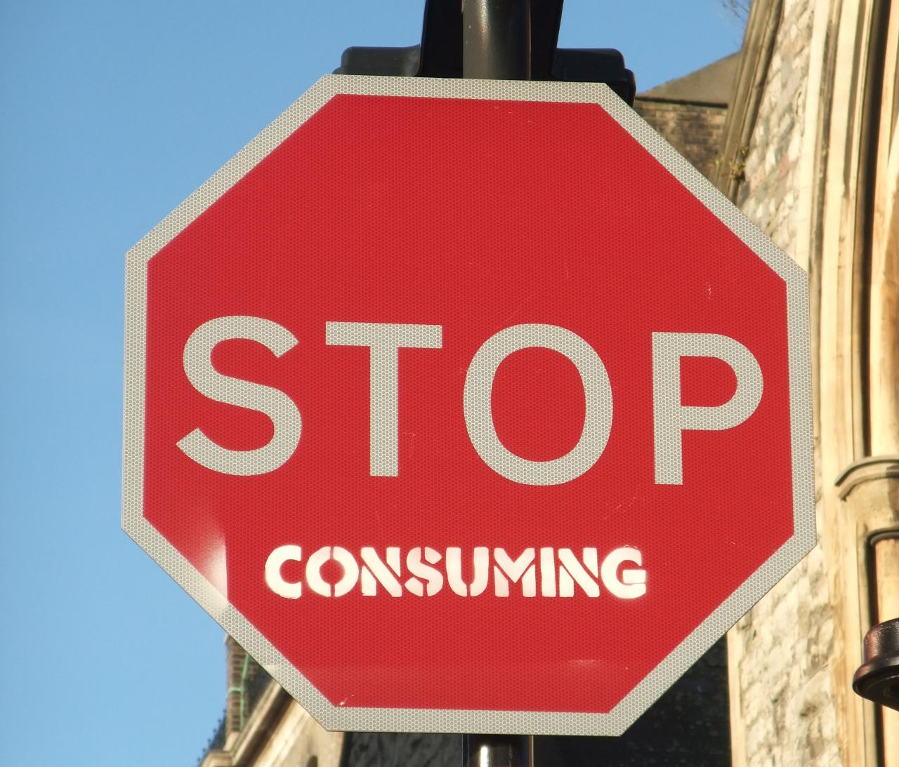 Stop sign with the word 'consuming' added to it, so that it reads 'STOP consuming'
