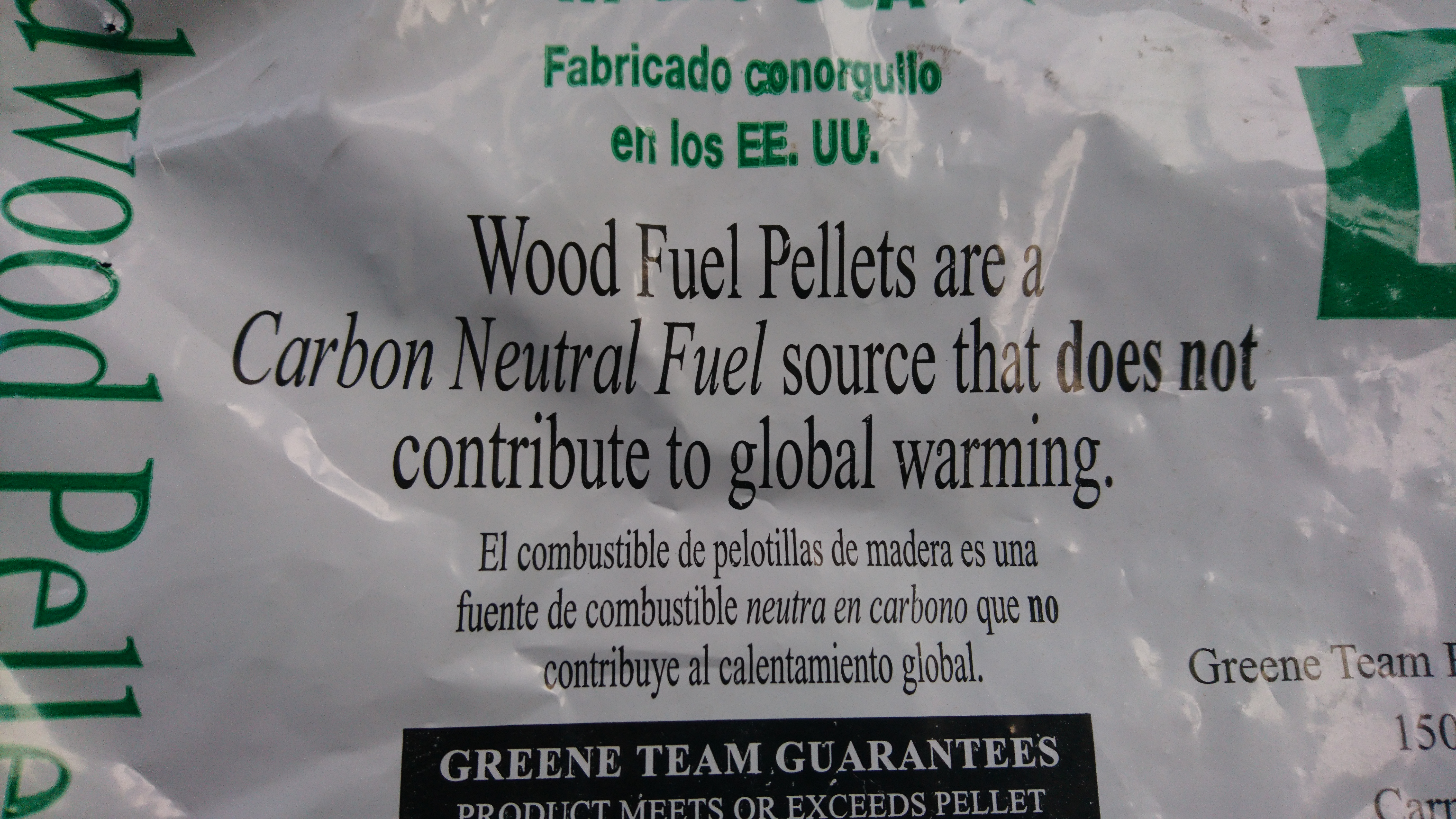 "image of ""carbon neutral"" label on a bag of wood pellets"