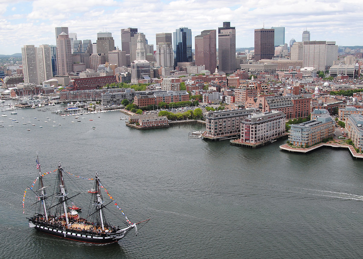 Boston Harbor with big sail boat in water