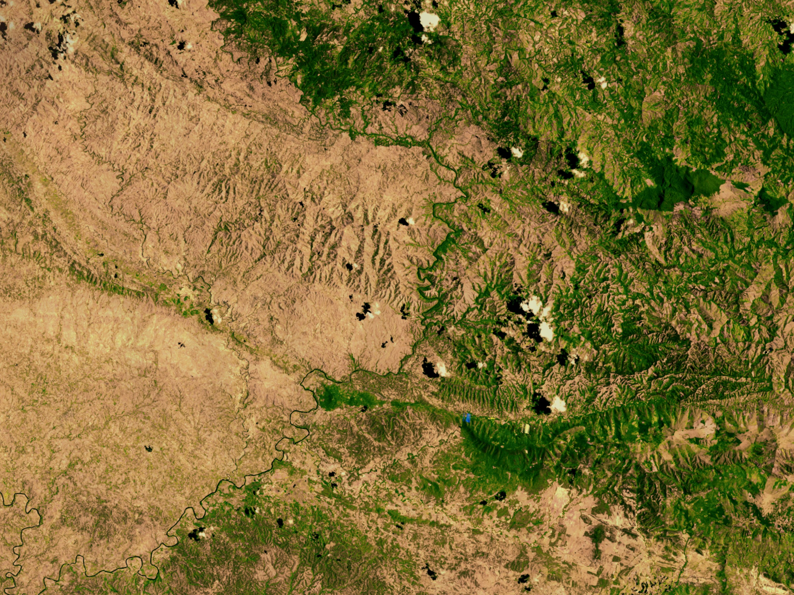 Green Forested Domincan Republic and Brown Deforested Haiti as viewed from space.