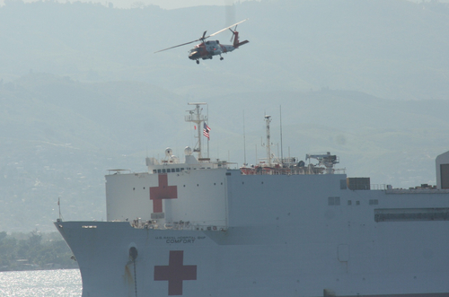 USNS Comfort Red Cross ship and a helicopter in Haiti.