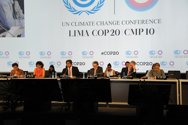Men and women talking at the UN Climate Change Conference in Lima