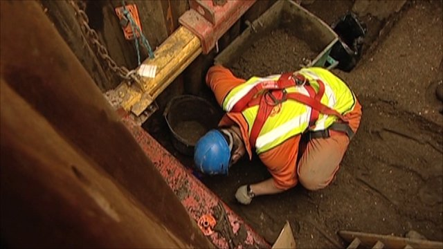 man in the Crossrail Tunnel archaeology dig in London, England.