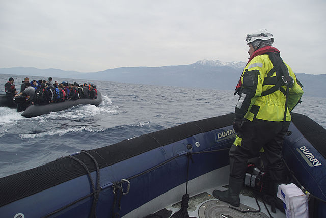 boat full of refugees in mediterranean sea off coast of greece