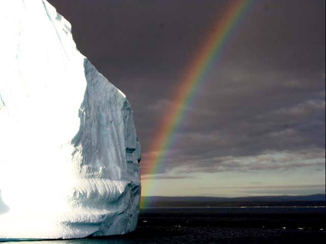 Rainbow and an icerberg, NE Greenland National Park