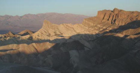 A mountain range along Death Valley. The foreground is in shadow.