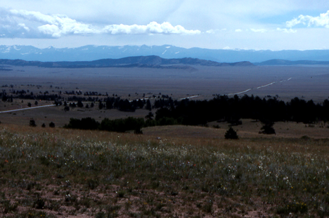 South Park viewed from Wilderson Pass.  Fields in front of the mountain range.