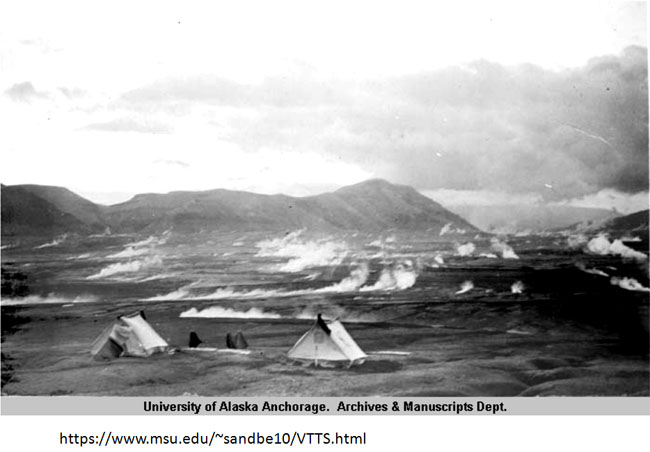 old photo of tents in a valley with steam coming out of ground in background