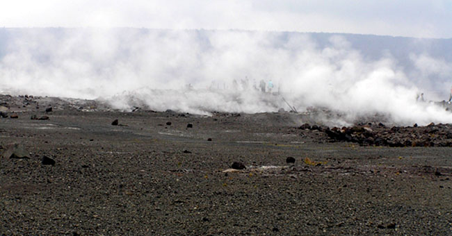 volcano from the rim with steam rising off of it