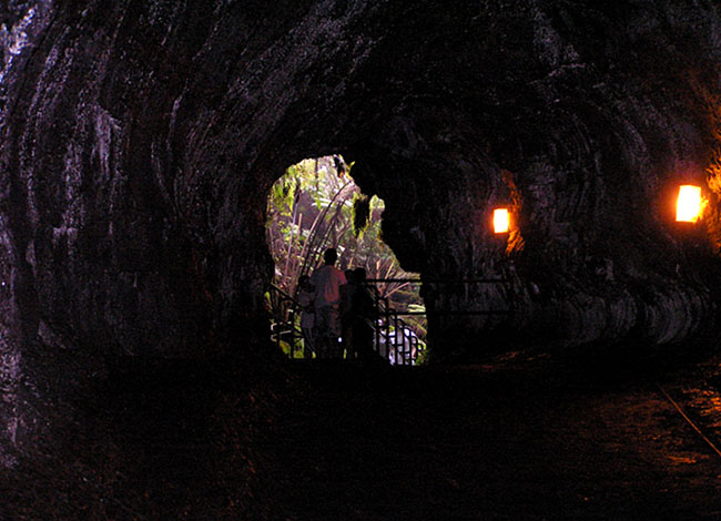 lava tube, or tunnel. There are lights in the tunnel and you can see people and the outside from one end.