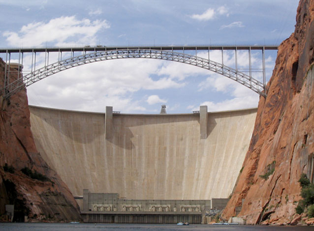 The Glen Canyon dam and highway bridge, viewed from a raft on the Colorado River below the dam