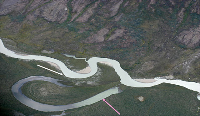 Arial view of stream Sondresermilik Fjord, S. Greenland.  One arrow points to oxbow lake, one points to levees separating stream from lake