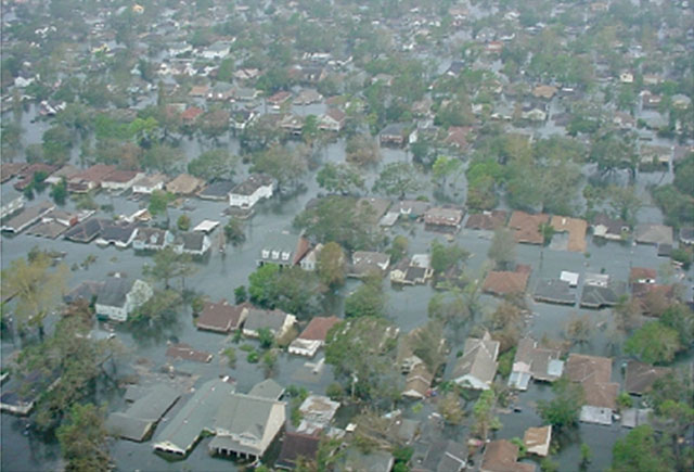 Arial view of flooded New Orleans after Hurricane Katrina 2005. Rooftops and tree tops surrounded by water