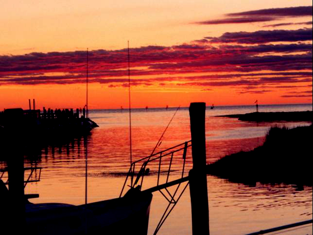 Sunset at Rock Harbor, Cape Cod.  Boats docked on left