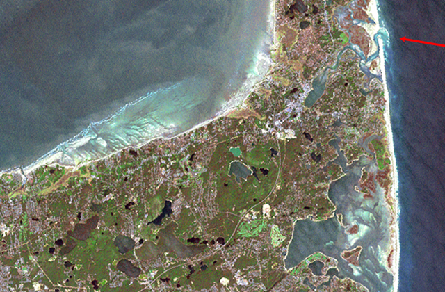 Satellite image of Cape Cod. Arrow in upper right points to inlet to Nauset marsh piercing the great barrier beach