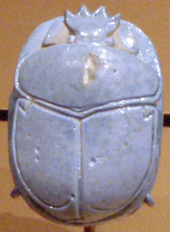 Egyptian scarab beetle, carved in clay and glazed sky blue