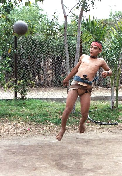 An ulama player in action in Sinaloa. Player jumping to kick or hit incoming ball