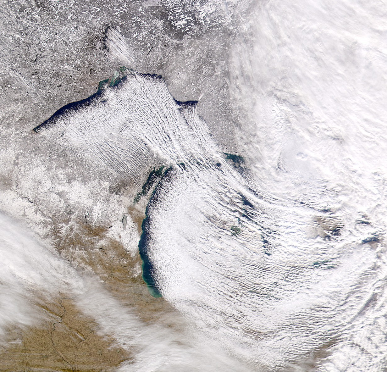 Satellite image of lake-effect snow bands over the Great Lakes.