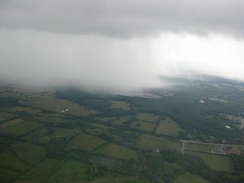 aerial view of cloud over farmland