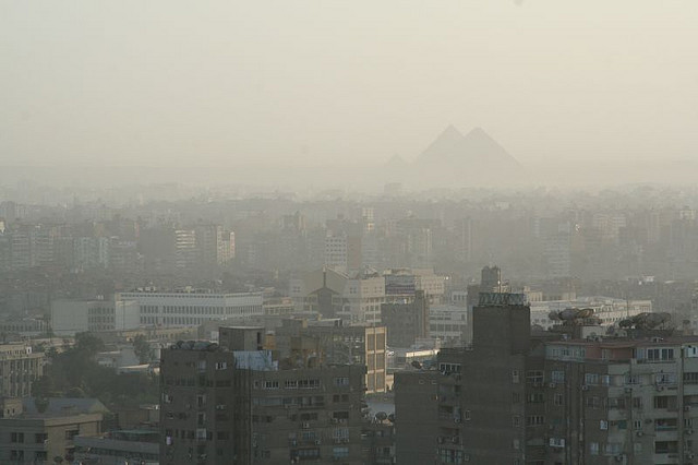 smog over Cairo, Egypt with pyramids in background