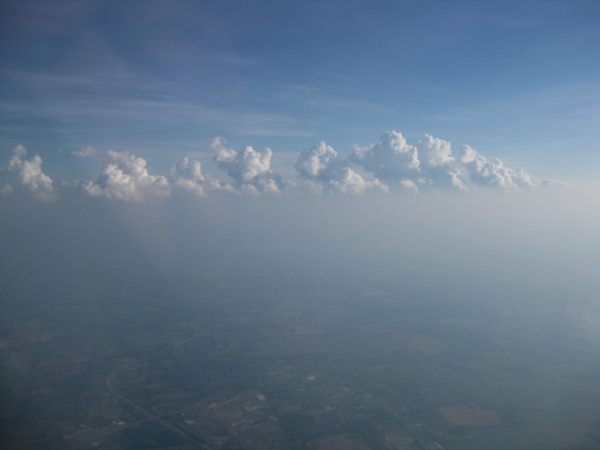 cumulus riding on top of a hot hazy summer atmospheric boundary layer as seen from above