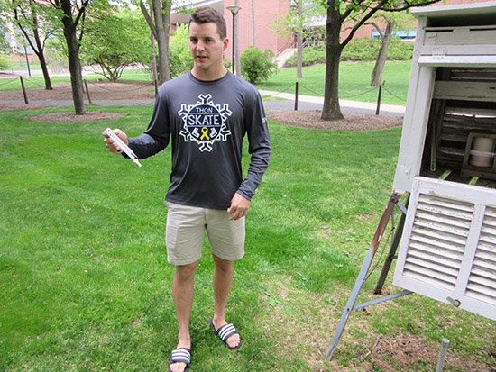 man using sling psychrometer
